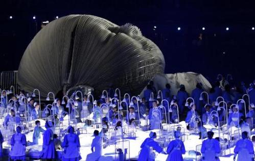 Creepy NHS-worship at the opening ceremony, XXX Olympiad; Photo credit: J.S. Hong, AP (h/t Thoughts from a Conservative Mom)