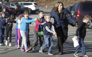Students led to safety at Sandy Hook (AP Photo/Newtown Bee, SHannon Hicks)
