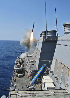 USS Barry (DDG-52), which might close her range with Syria this month, firing a Tomahawk in 2011 (U.S. Navy photo by LTJG Monika Hess/Released)