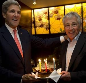 Kerry, taking time off from promising not to regime-change Kim Jong-Un, surprises Hagel with a birthday celebration in Tokyo.  Reuters pool photo