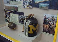 A replica of the Little Brown Jug on display at Michigan. (The original, which carried Coach Fielding Yost's water, is kept in storage.)