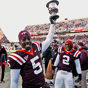 Hokies with their favorite trophy.