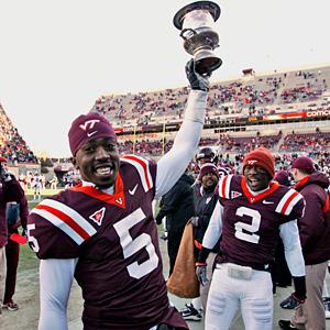 Hokies with their favorite trophy.
