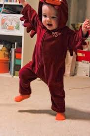 Littlest Hokie fan, doing The Hokie.