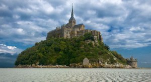 Mont St. Michel, site of the famous 8th-century monastery. Would you surround it with offshore wind turbines? (Photo credit: Giuseppe Citino)