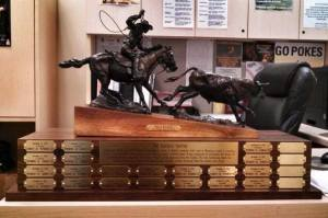The new Paniolo Trophy, its base suitably emblazoned with UW victories.