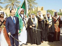 France's Francois Hollande and the Saudis plan Lebanon's future as 2013 draws to a close. (Photo credit: SPA)