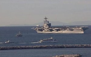 USS George H. W. Bush entering Piraeus in early March. (Photo from Twitter user ΛΑΘΡΟΒΙΩΝ-antisocial)