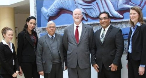Shaun Casey of the US State Dept. visits Dr. Bishara Awad, president of the Bethlehem Bible College, Feb 2014.