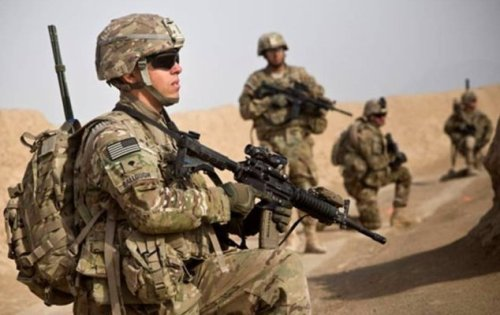 US Army infantrymen on patrol in Kandahar Province, Afghanistan. (Image: Reuters, Andrew Burton)