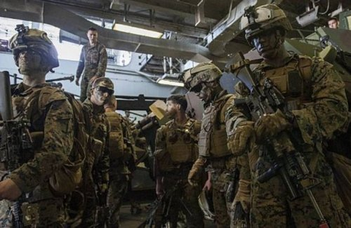 US Marines prepare to deploy from the well deck of USS Bataan (LHD-5) in the Atlantic. (US Navy image)