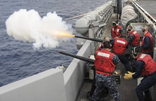 Navy sailors conduct a gunfire exercise on USS Nimitz (CVN-68) underway in the Pacific. (US Navy image)