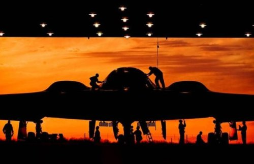 USAF maintenance crewmen work on a B-2 Spirit stealth bomber at Whiteman AFB, Missouri (Image AFP)