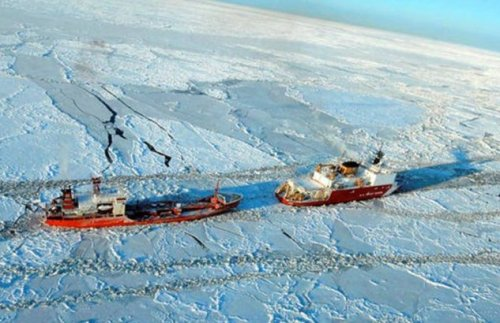 US Coast Guard Cutter Healy (WAGB-20) cuts a path through Arctic ice in support of a winter resupply mission to northern Alaska. (USCG photo)