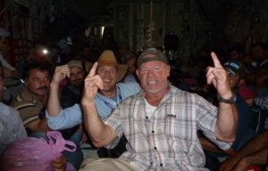 American contractors celebrate being evacuated from Balad Air Base by Iraqi forces on Friday, 13 June. (Image via WND)
