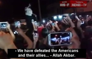 Awfully interested in victory over Americans, ISIS is. (Image via MEMRI, from ISIS rally after the fall of Mosul)