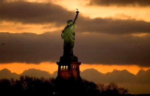 Lady Liberty faces the dawn. (Image: USA Today, Robert Deutsch)