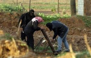 Hamas terrorists prepare a mortar launcher. (File image via Al Arabiya)