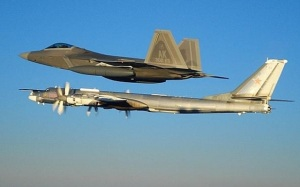 An F-22 from the 302d Fighter Squadron at Elmendorf AFB, AK intercepts a Russian Tu-95MS Bear H. (USAF image)