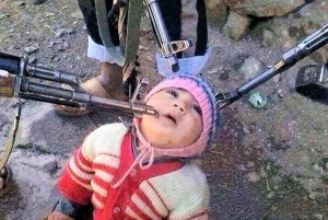 """Reason, Islamist-style.  Image of """"our youngest hostage"""" reportedly loaded to Twitter by Syrian jihadis, April 2014. (Via UK Daily Mail)"""