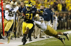 Let the wild rivalries begin. Michigan-Notre Dame 2013, when fans went to a soap opera and a football game broke out.  Michigan WR Jeremy Gallon sprints for major inches. (Image: wsbt.com via Twitter, James Brosher)