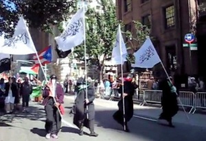 Raising the flag of the caliphate for justice & peace.  2013 Muslim Day parade.