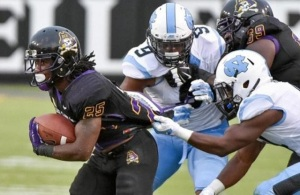 East Carolina's RB Breon Allen, picking up some of his total 600 yards to date in the UNC game. (Image via WRALSports.com)