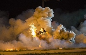 Protester throws back a smoke bomb deployed by police, 13 August.  (Image: Reuters via UK Daily Mail)