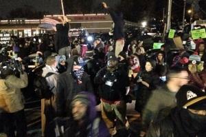 Ferguson crowd awaits the grand jury report in Ferguson. (Image via Twitter)