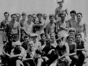 Simon with the crew of HMS Amethyst (held by man standing in third row).