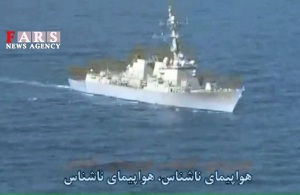 Mighty Iranian navy takes picture of U.S. destroyer.