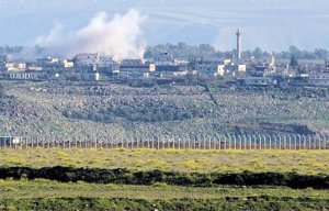 Syrian fighting viewed from Israel in the Golan, 2013. (Image: JINI, Ancho Gosh via Israel Hayom)