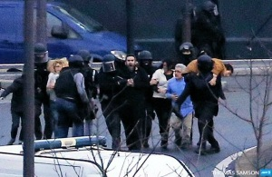 Barbarism: Hostages are evacuated from the Jewish market in Paris where associates of the Charlie Hebdo terrorists made their last stand. (Image: AFP, Thomas Samson via Twitter)