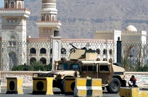 A Houthi rebel watches outside the presidential palace in Sanaa, Yemen during the siege 19-22 Jan. (Image via CNN)