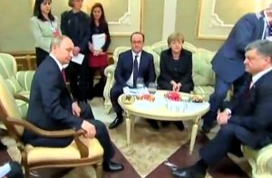 A gathering of giants in Minsk. (Image via Guardian video)