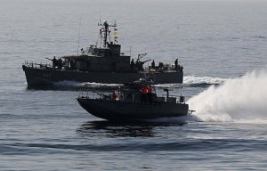 Superbad.  An Iranian speedboat and Kayvan patrol boat, the new law in the SOH. (Image: Fars via Uskowi on Iran)