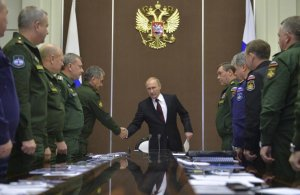 Putin confers with his senior military officials. (Image: Kremlin/RIA Novosti, Alexei Druzhinin via Newsweek)